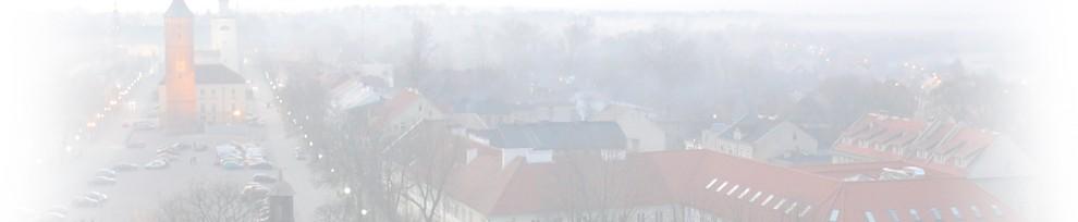 Grafika przedstawiająca miasto we mgle.